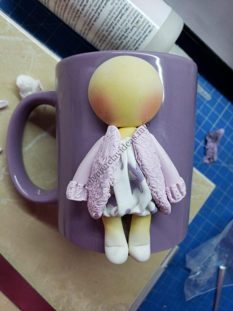 5 Polymer clay decor: Doll dressed up in winter clothes
