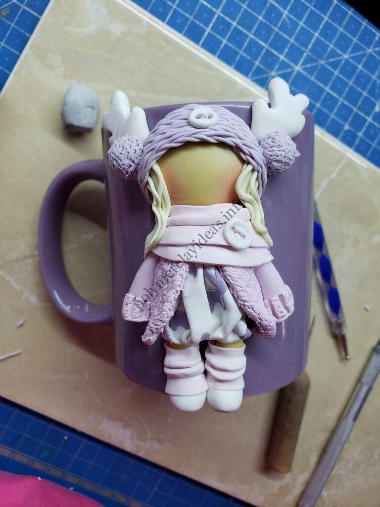 7 Polymer clay decor: Doll dressed up in winter clothes