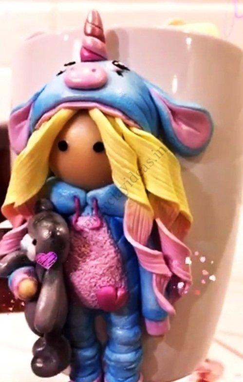 Polymer clay decor: Doll in a unicorn costume